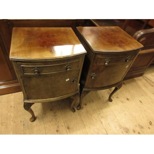 1621 - Pair of mid 20th Century figured walnut bow front bedside cabinets on cabriole supports...