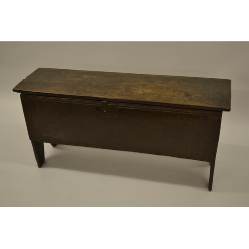 1629 - 17th Century oak plank coffer, the gouge lined hinged lid above a similarly decorated front with iro...