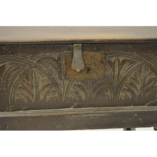 1630 - 17th Century oak bible box, the plain hinged lid above a carved front panel with iron lock plate and...