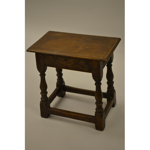 1633 - Good quality reproduction oak joint stool in 17th Century style, the moulded top above a carved frie...