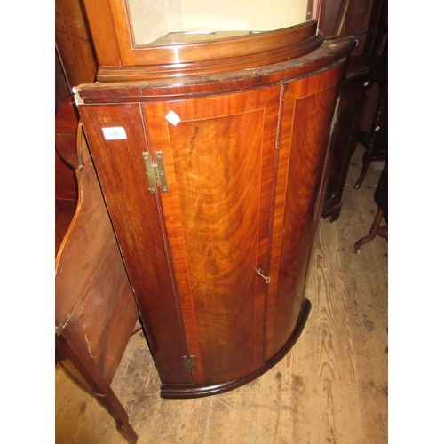 1646 - George III mahogany crossbanded and line inlaid bow front hanging corner cabinet...