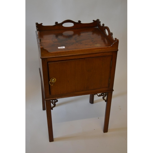 1648 - George III mahogany bedside cabinet with a galleried top above a single panelled door raised on squa...