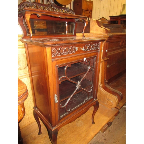 1649 - Edwardian mahogany music cabinet with a pierced and mirrored back above single drawer and a glazed d...