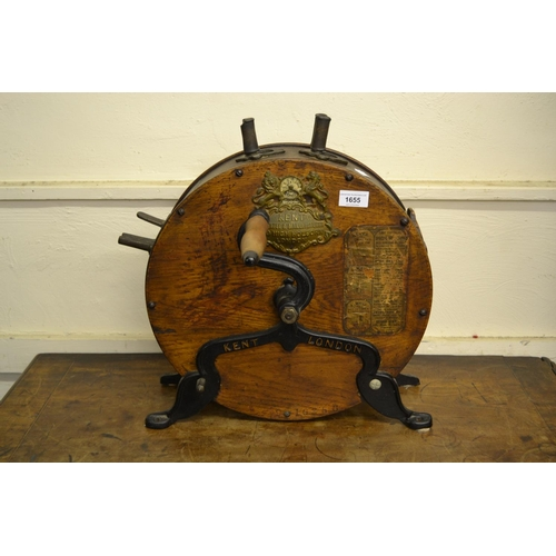 1655 - 19th Century Kent of London, oak and iron knife polisher, together with a John Oakey tin of polish...