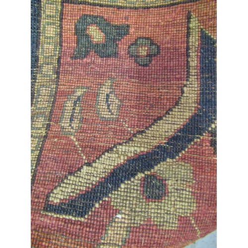 2 - Agra carpet of all-over floral design on burgundy ground with multiple borders, 119ins x 167ins...