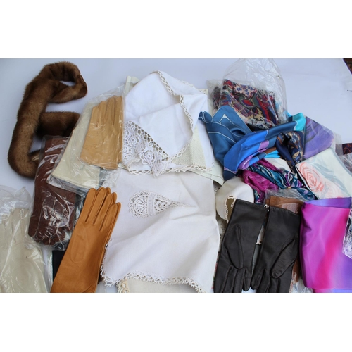 21 - Bag containing a quantity of ladies silk scarves and leather gloves, together with a small quantity ...
