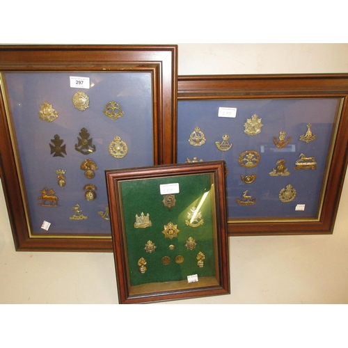297 - Three frames containing a collection of various military cap badges and buttons...