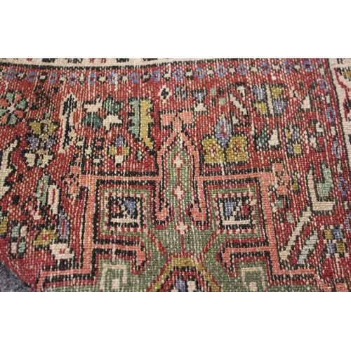 3 - Small Karaja rug with triple medallion and multiple borders on wine ground, 38ins x 26ins together w...