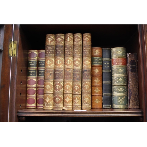 325 - Five volumes ' The Russo Japanese War ' leather bound, two leather bound volumes ' Vanity Fair ' and...