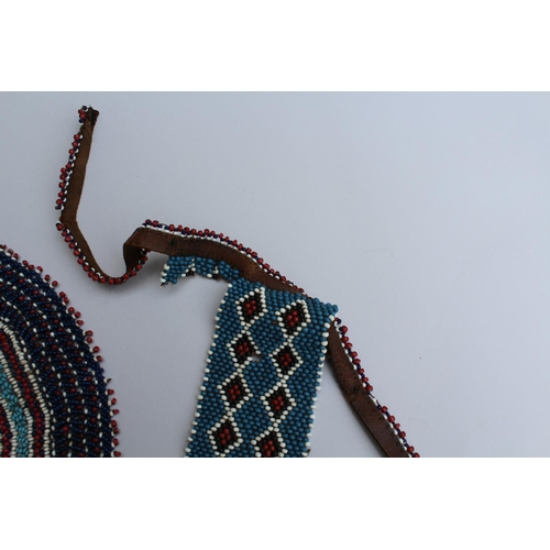 33 - Late 19th or early 20th Century African or possibly North American Indian bead work and leather belt...