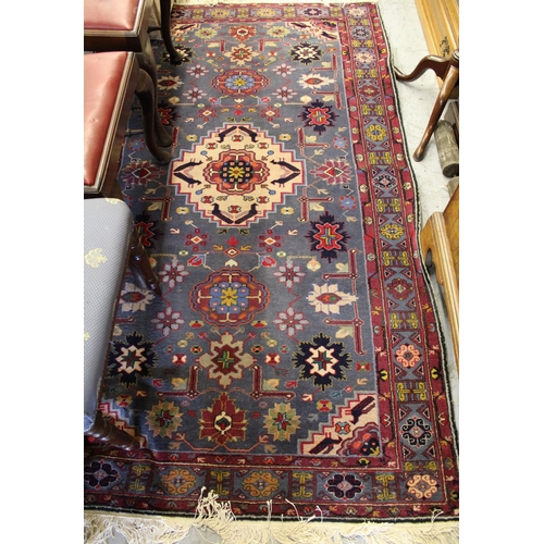 5 - Mid to late 20th Century Belouch rug with a medallion and all-over stylised flower head design on a ...