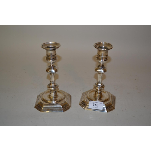 553 - Pair of Edwardian silver knopped stem candlesticks in Georgian style, London 1901, 7ins high...
