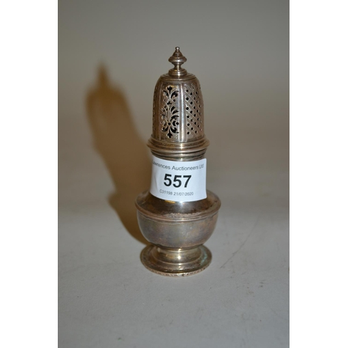 557 - George III silver baluster form pepper, the base later mounted with a Spanish silver coin...