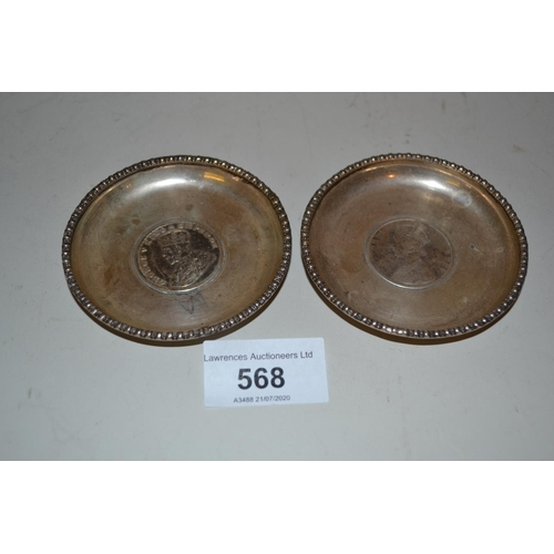 568 - Pair of small white metal dishes inset with Indian one rupee coins...