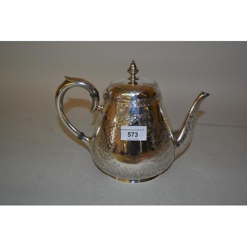 573 - Victorian circular floral engraved silver teapot, London 1880...