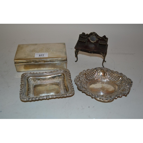 577 - Sterling silver cigarette box, two silver dishes and a white metal mounted model of a dressing table...