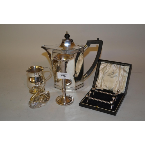 579 - Silver spill vase together with a plated coffee pot, Christening mug, cased knife rests and a salt i...