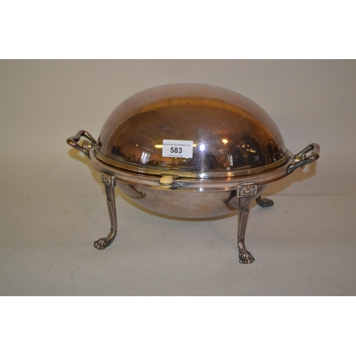 583 - Oval silver plated roll-over bacon dish on claw supports...