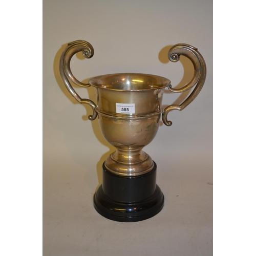 585 - Birmingham silver two handled trophy cup on an ebonised plinth...