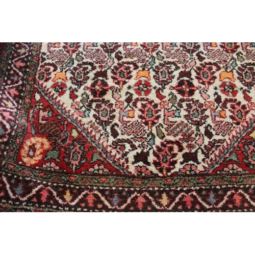 6 - Small mid 20th Century Belouch rug with an all-over stylised geometric design and borders in shades ...