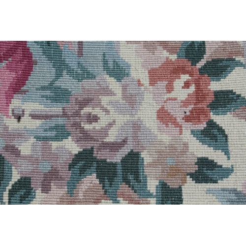 7 - Chinese woollen floral decorated carpet on pink ground...