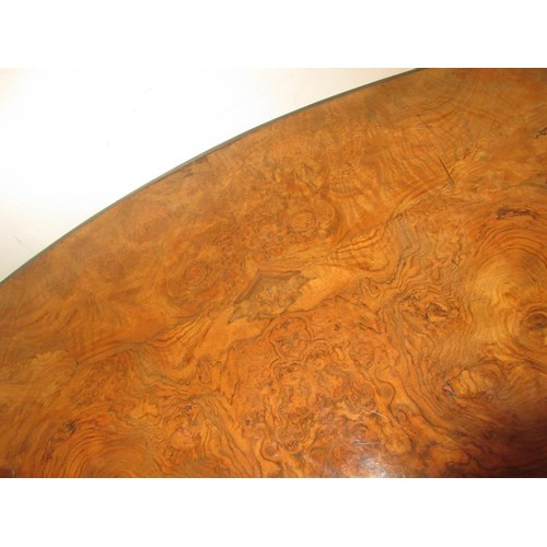 1638 - Victorian oval figured walnut tilt-top loo table on turned column and quadruped splay support...