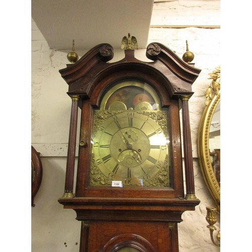 1120 - 18th Century oak longcase clock, the broken arch hood above an arched panelled door and conforming p...