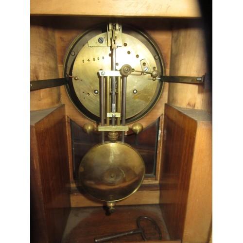 1134 - Victorian figured walnut and ebonised mantel clock, the circular white enamel dial with Roman numera...