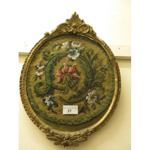 21 - Victorian oval gilt framed beadwork panel, together with a framed silkwork panel, a bird in foliage ...