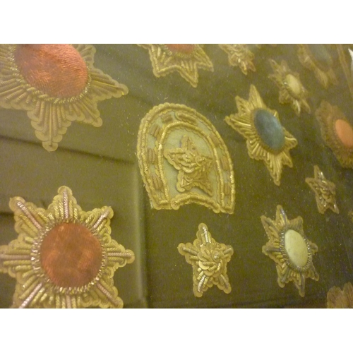 26 - Maple framed collection of 19th Century silver and wirework velvet badges in the form of stars and h...