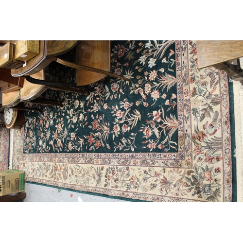 3 - Small Indo Persian carpet with an all-over floral and bird design on a green ground with borders, 9f...