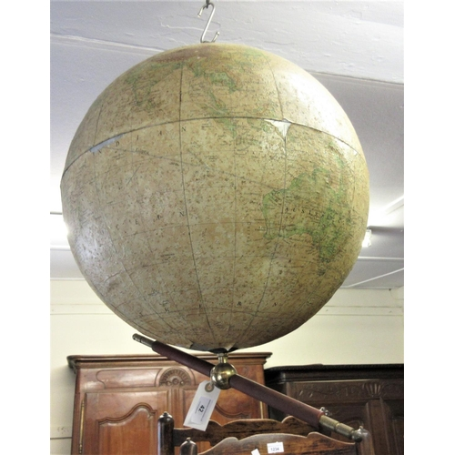 42 - Philips' 19in terrestrial globe, the aluminium body with paper covering and brass suspension system...
