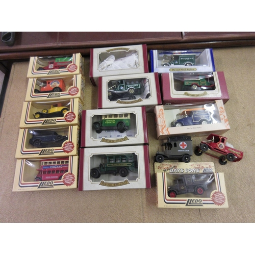 49 - Small quantity of various boxed diecast metal cars and a quantity of loose cars...