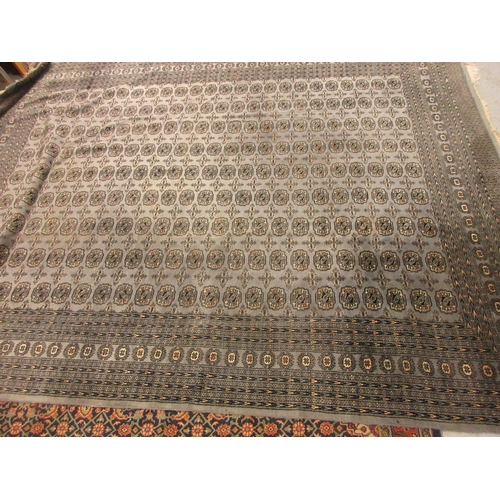 5 - Pakistan carpet of Bokhara design on a blue grey ground, 12ft x 9ft approximately...