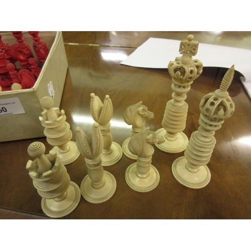 50 - Good quality 19th Century natural and red stained ivory chess set with carved and turned decoration,...