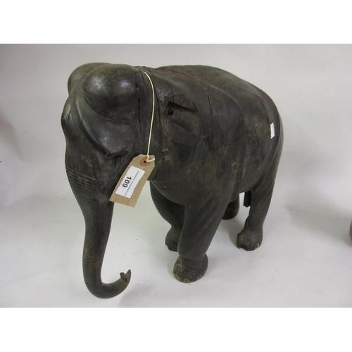 109 - Large antique ebony figure of an elephant (at fault, lacking ears, tusks etc.), 15ins high...