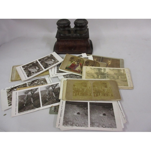 115 - Small Victorian figured walnut stereoscope together with a quantity of cards...