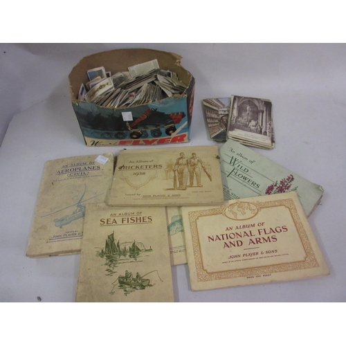 117 - Box containing a large collection of loose cigarette cards, various albums of cigarette cards and a ...