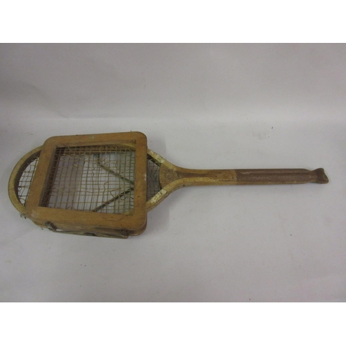 118 - Vintage tennis racket with fish tail handle, together with three other vintage tennis rackets...