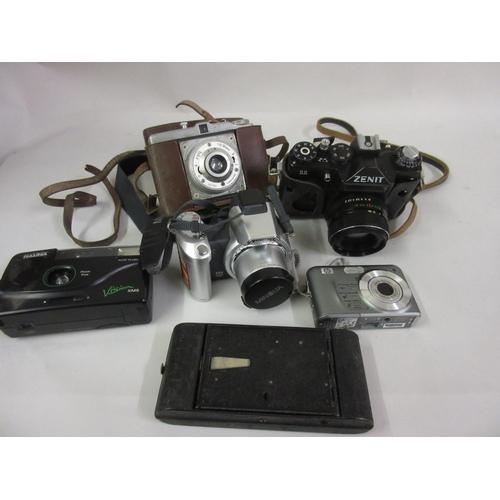 120 - Box containing a quantity of various cameras including Minolta, Zenit, SLR etc....
