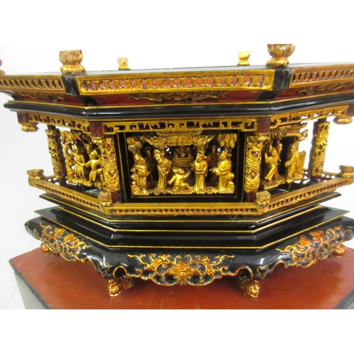 129 - Early 20th Century Chinese black lacquer altar stand of irregular hexagonal form, the removable cove...