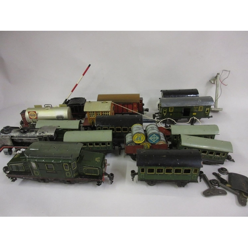 135 - Quantity of 0 gauge tin plate model railway, including a Marklin locomotive, miscellaneous rolling s...