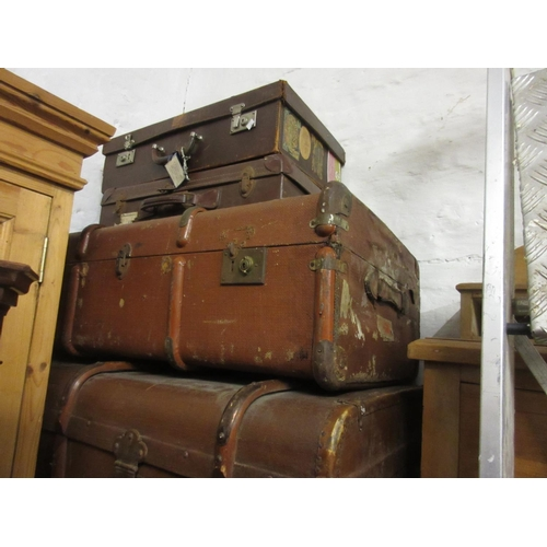 141 - Group of five vintage travelling trunks, some with contemporary luggage labels, together with a leat...