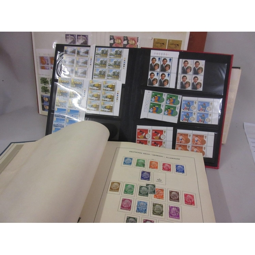 144 - Schaubek album containing a collection of European stamps, together with a box containing various al...