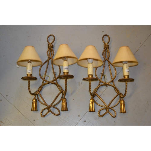 1483 - Pair of early to mid 20th Century gilt brass twin light wall sconces of rope and tassel design, 20in...