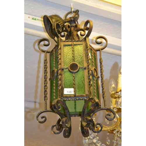 1487 - Early 20th Century wrought iron hall lantern of hexagonal form decorated with scroll work and inset ...