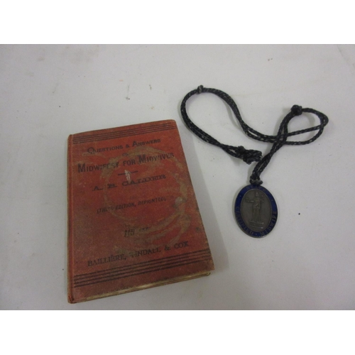 149 - Unnamed Military Cross medal in original box (at fault), together with a state certified Midwife med...