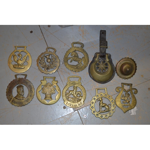 1499 - Collection of ten various horse brasses, brass trivit, an antique copper kettle and other items of c...