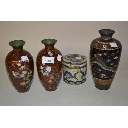 1502 - Pair of cloisonne baluster form vases decorated with birds on a gold flecked ground, 7.25ins high, t...