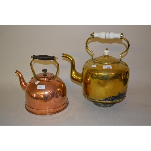 1514 - Large brass kettle with ceramic handle and a smaller copper kettle...